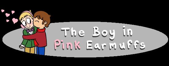 boy in pink earmuffs